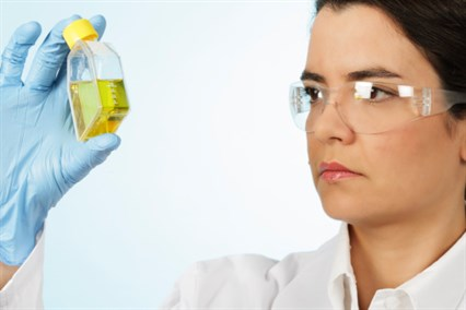 Scientist with sample bottle_133498571